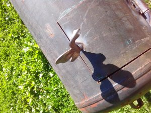 Detalle de la palometa de la puerta del horno de cilindro